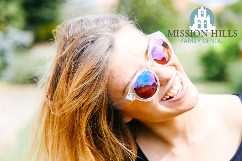 Teenage girl smiling with sunglasses on
