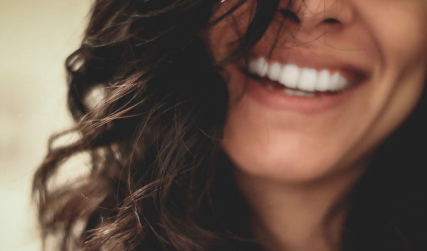 woman's smile from dental porcelain veneers