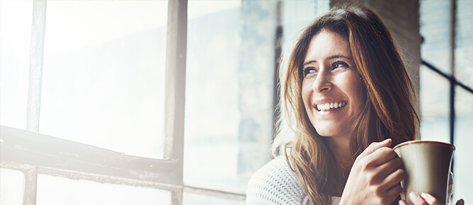 Woman smiling looking out window