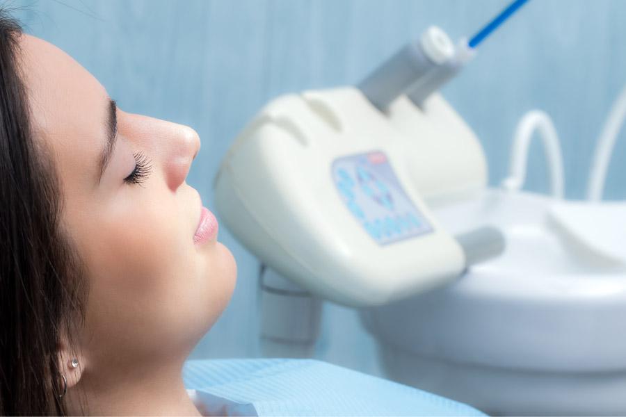 woman under dental sedation awaiting a dental procedure