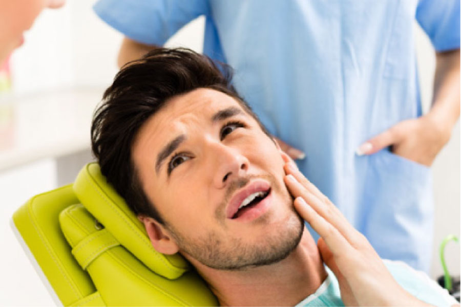 young man in the dentist chair getting ready for a tooth extraction